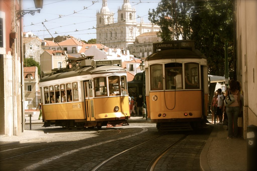 photo of trams in old town Lisbon